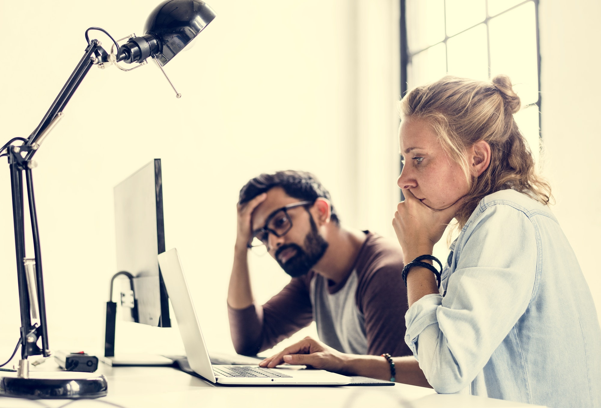 People thinking about to fix something on computer