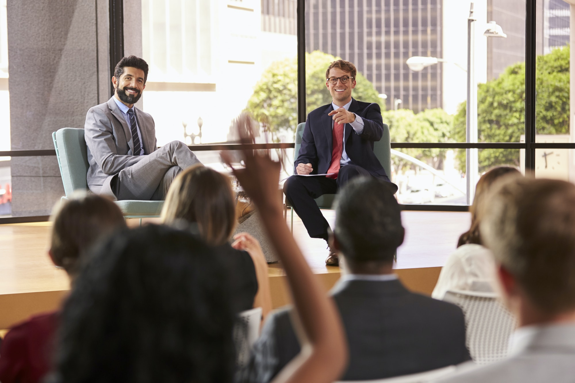 Speakers at a business seminar take questions from audience