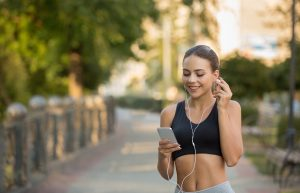 Girl choose music for running on smartphone