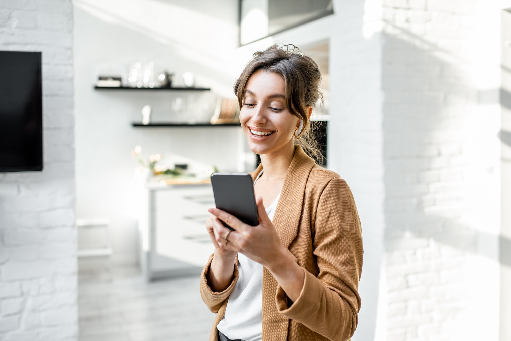 Business woman with smart phone at home